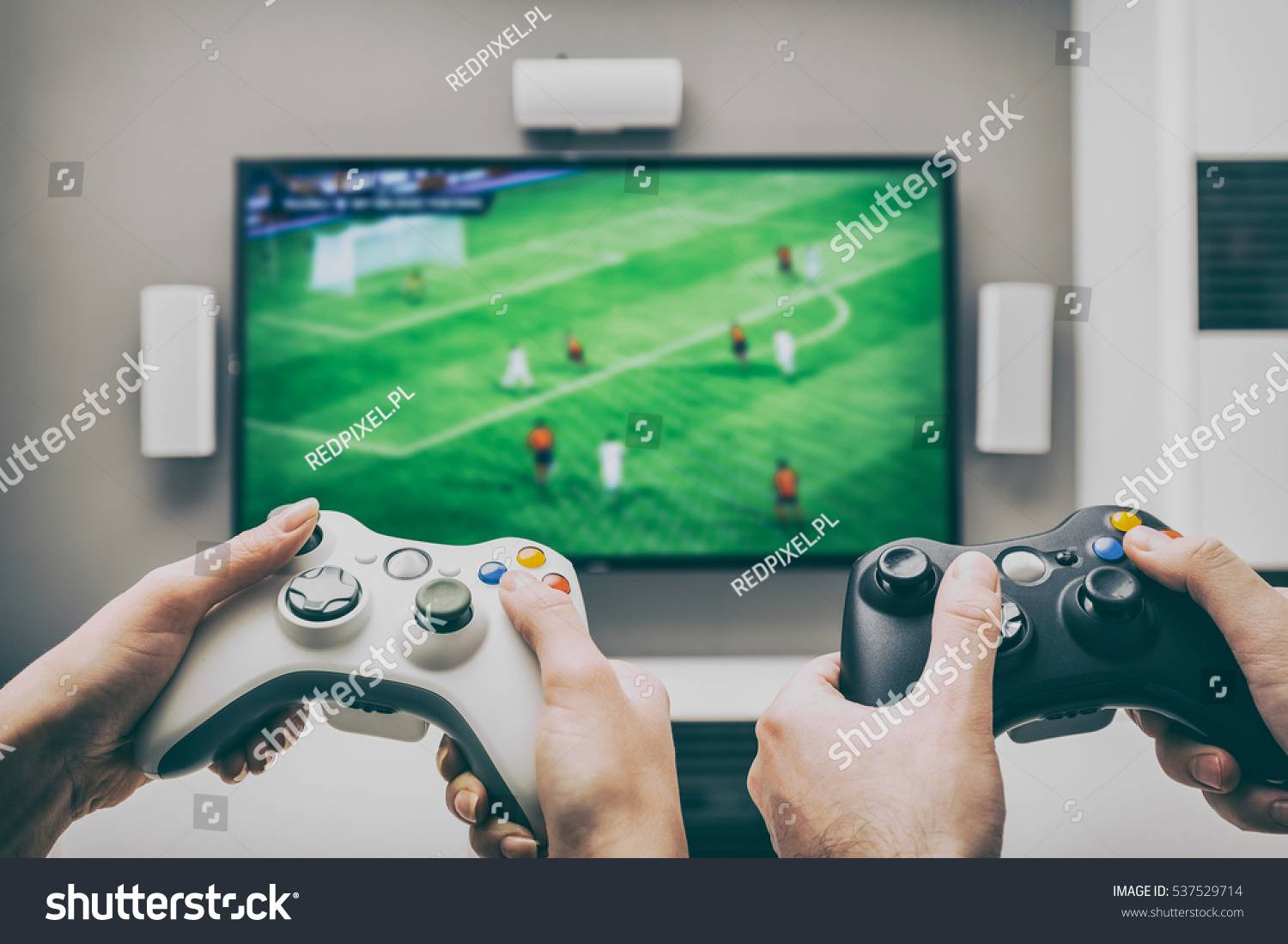 stock-photo-gaming-game-play-tv-fun-gamer-gamepad-guy-controller-video-console-playing-player-holding-hobby-537529714.jpg